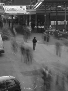 person alone in a crowd