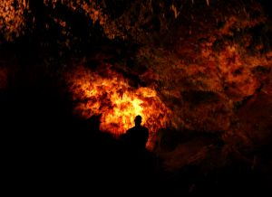 Figure in a fiery cave. Ghosts and demons?