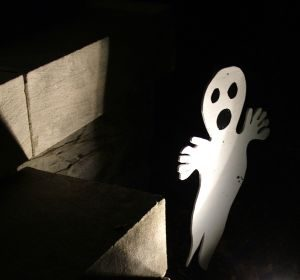 ghost figure in haunted house attraction